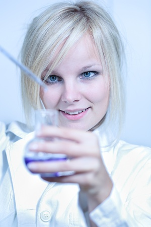 titration: Closeup of a female researcher carrying out experiments in a laboratory Stock Photo