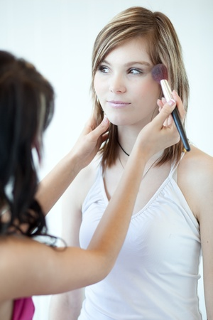 pretty young woman having powder applied by a make-up artist/beautician Stock Photo - 9906960