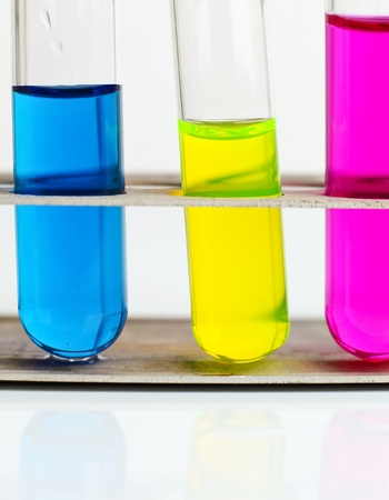 yellow yellow lab: science concept - chemistry lab glassware equipment (test tubes with colorful substances)