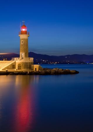 夕暮れ時の灯台 写真素材