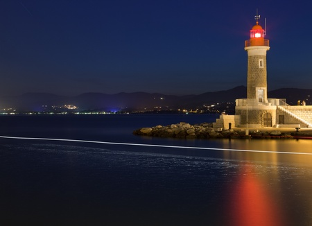 Lighthouse at dusk in Saint-Tropez, France photo
