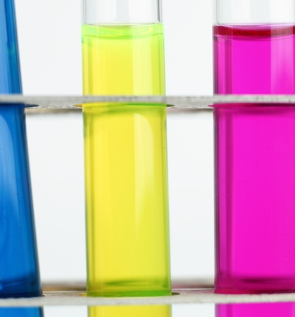 science concept - chemistry lab glassware equipment (test tubes with colorful substances) photo