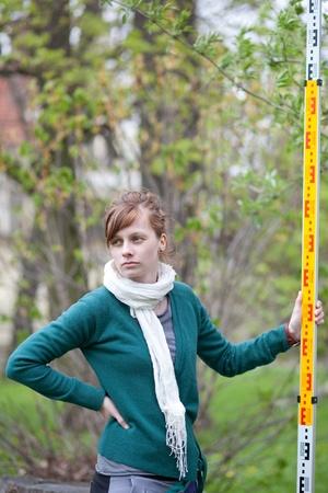 geodesy: young land surveyor at work