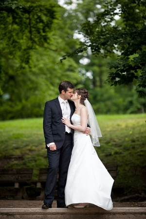 young wedding couple - freshly wed groom and bride posing outdoors on  their wedding day Stock Photo - 9915428