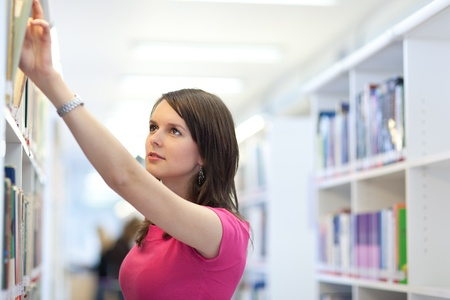 pretty young college student in a library (shallow DOF; color toned image) Stock Photo - 9926374