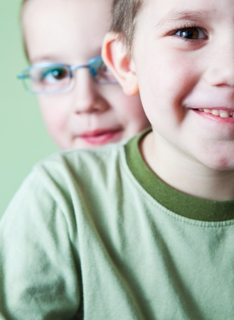 two little brothers happy together (shallow DOF; color toned image) photo