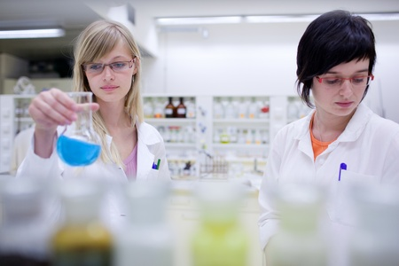 two female researchers carrying out research in a chemistry lab Stock Photo - 9926220