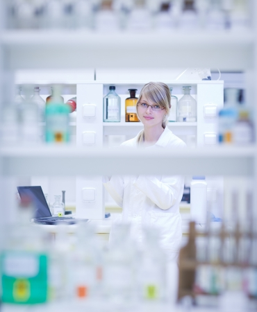 research worker: portrait of a female researcher carrying out research in a chemistry lab  Stock Photo