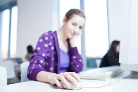 pretty young college student in a library (shallow DOF; color toned image) Stock Photo - 9915623