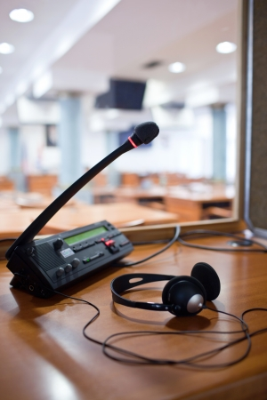 interpreter: interpreting - Microphone and switchboard in an simultaneous interpreter booth Stock Photo
