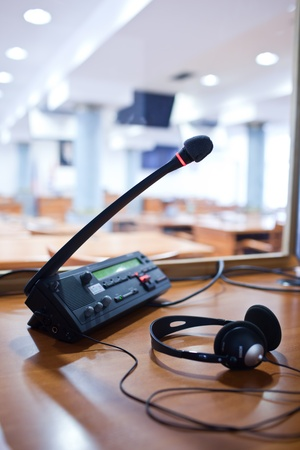 simultaneous: interpreting - Microphone and switchboard in an simultaneous interpreter booth Stock Photo