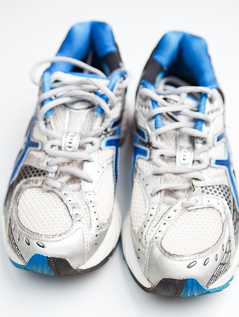 Pair of running shoes on a white background photo