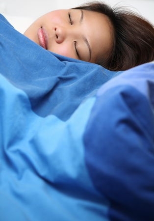 peacefully: Young asian woman sleeping peacefully