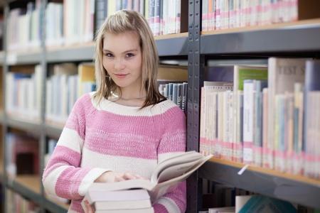 pretty female college student in a llibrary photo