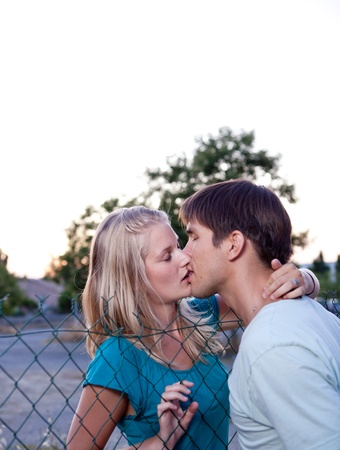 french kiss: Young lovely couple kissing lovingly Foto de archivo