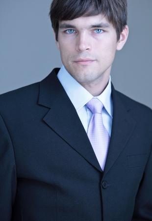specialized job: Close-up portrait of a young handsome confident businessman