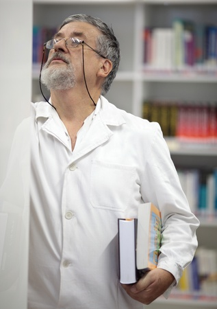 Renowned scientistdoctor in a library of research centerhospital searching for a publicationbookarticle photo