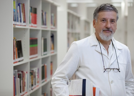 Renowned and confident-looking scientistdoctor in a library of research centerhospital  photo
