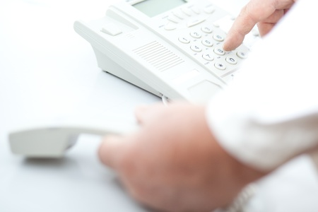man making a phone call, dialing the number (white telephone on white background) Stock Photo - 10414126