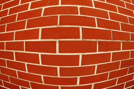 catchy: intentionally distorted red wall as a catchy backgroundtexture Stock Photo