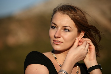 close-up portrait of a pretty young blonde woman outdoors photo