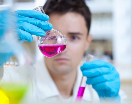 chemical laboratory: young male researcher carrying out scientific research in a lab Stock Photo