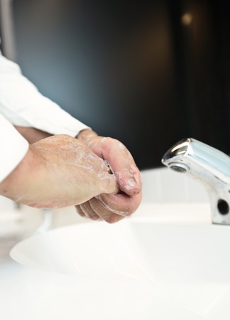 � fond: Fludisease prevention - Washing hands thoroughly with running water and soap Banque d'images