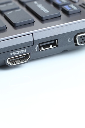 USB & HDMI - modern hi-end carbon laptop computer with great connectivity on white background Stock Photo - 10414141