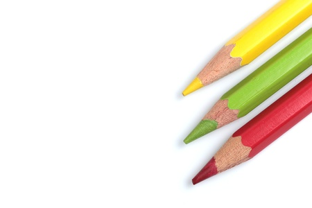 color pencils (red, yellow and green) close-up isolated on white background photo