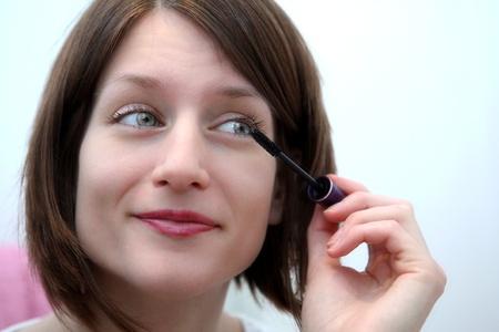 Beautiful young woman applying mascara Stock Photo - 9939887
