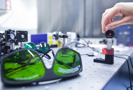 female scientist doing research in a quantum optics lab (color toned image) photo