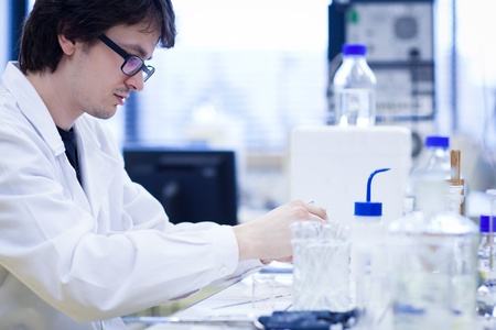 young male researcher carrying out scientific research in a lab Stock Photo - 9960370