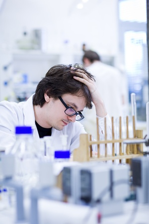 young male researcher carrying out scientific research in a chemistry lab Stock Photo - 9960363