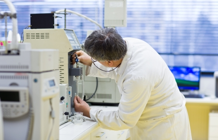 senior male researcher carrying out scientific research in a lab (shallow DOF; color toned image) Stock Photo - 10405425