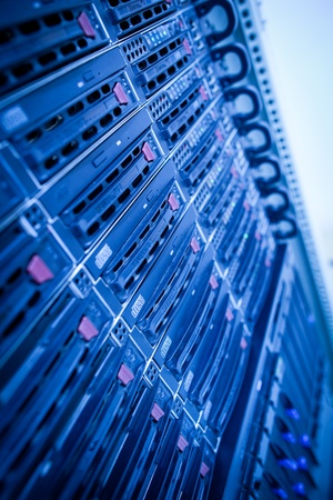 rack: Server rack cluster in a data center (shallow DOF; color toned image)