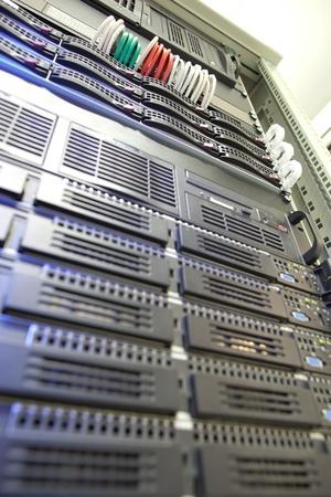 dof: Server rack cluster in a data center (shallow DOF; color toned image)