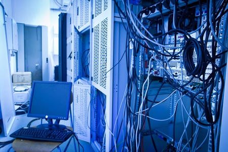 Server rack cluster in a data center (shallow DOF; color toned image) Stock Photo - 10364669