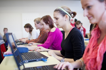 college students sitting in a classroom, using laptop computers during class (shallow DOF) photo