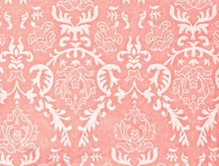 light pink vintage background with damask-like ornamental pattern photo
