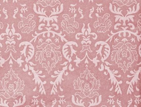 light pink vintage background with damask-like ornamental pattern photo
