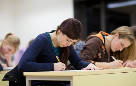 students in a classroom during classwriting a test  Stock Photo