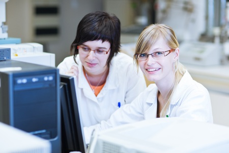 laboratory technician: two female researchers in a chemistry lab (color toned image; shallow DOF)