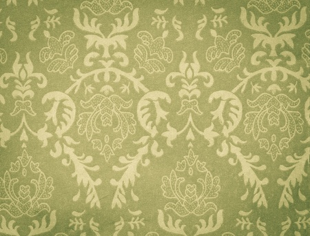 faded green vintage background with damask-like ornamental pattern photo