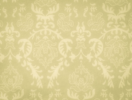 faded low contrast green-yellow vintage background with damask-like ornamental pattern photo