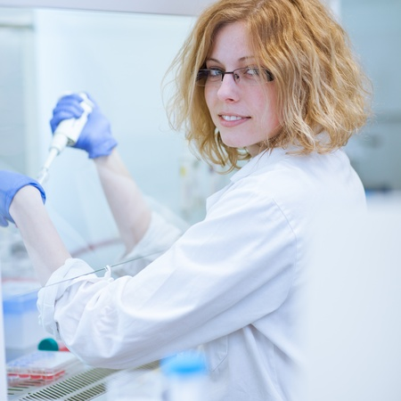 portrait of a female researcher doing research in a lab (shallow DOF; color toned image) photo