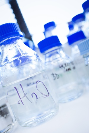Glassware in a chemistry lab (shallow DOF; focus on the beakers in the foreground) photo