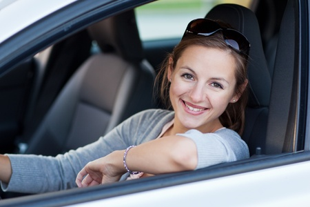 Pretty young woman driving her new car Stock Photo - 11101689