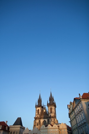 tynsky church: View of the Church of Our Lady before Tyn (Tyn Church) and the houses of the Old Town Square in Prague at dusk Stock Photo