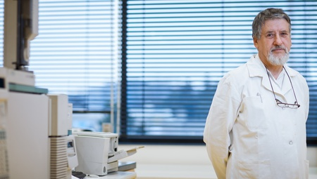 field study: Portrait of renowned scientistdoctor in a research centerhospital laboratory. Stock Photo