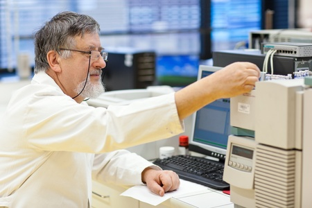 senior male researcher carrying out scientific research in a lab (shallow DOF; color toned image) Stock Photo - 11101833